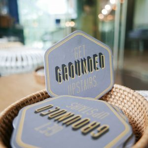 Grounded by CMCR coaster logo