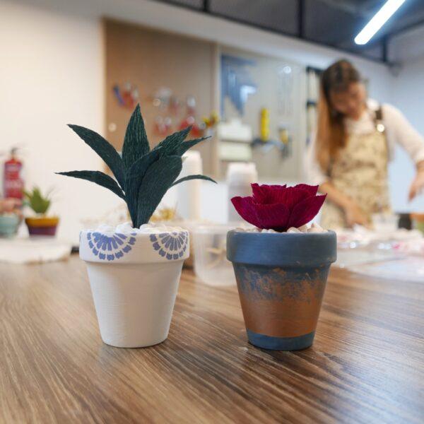 Pots with crepe paper succulents